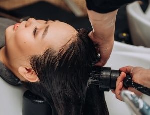 Lady pampering herself with a hair treatment
